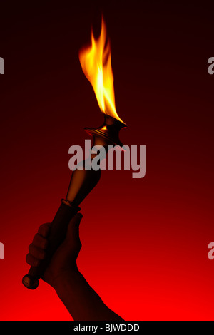 Olympic Torch with Red Sky - Stock Image