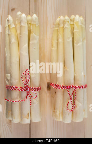 New harvest of white asparagus, two bunches high quality raw asparagus in spring season, ready to cook close up top view - Stock Image