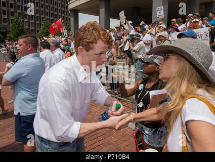U.S. Democratic Representative Joseph Patrick Kennedy III (Joe Kennedy), grandson of Robert Kennedy and grand-nephew of John F. Kennedy Shaking hands at Boston City Hall during the Rally against Family Separation in Boston, MA. Kennedy had spoken against U.S. President Donald Trump's policy of detaining immigrants and separating immigrant families.  Large rallies against President Trump's policy of separating immigrant families took place in more than 750 U.S. cities on June 30th of 2018. - Stock Image