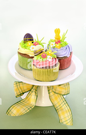 Easter cupcakes. Chocolate cupcakes with vanilla buttercream decorated with sugar decorations. - Stock Image