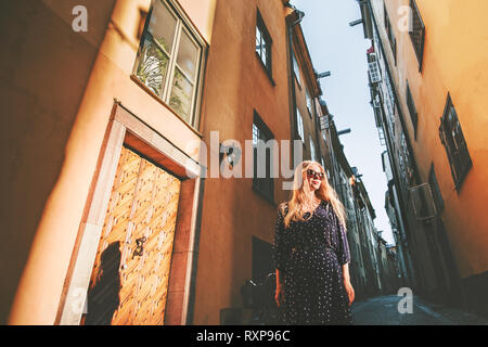 Girl tourist walking in Stockholm traveling alone fashion lifestyle summer vacations in Sweden city tour weekend - Stock Image