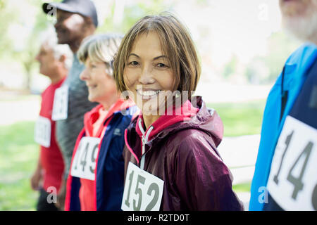 Portrait smiling, confident active senior woman at sports race starting line - Stock Image