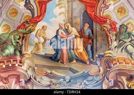 COMO, ITALY - MAY 8, 2015: The fresco of Visitation fresco in church Santuario del Santissimo Crocifisso by Gersam Turri (1927-1929). - Stock Image