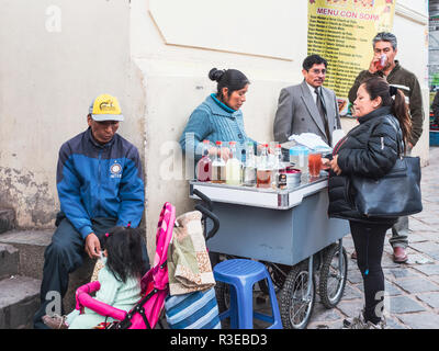 Cusco, Peru - January 3, 2017. View of the Cusco streets and the local buying food in street store - Stock Image