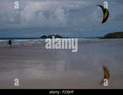 Kite surfer with Godrevy lighthouse in the background, Gwithian, Cornwall, UK - Stock Image