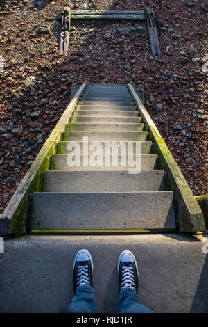 Steps down from the Thames Path onto the shore of the River Thames in London, UK. - Stock Image