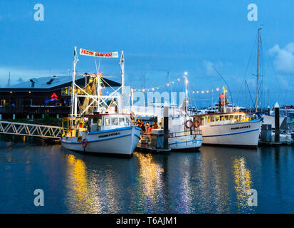 Fleet of prawn trawlers at Cairns Wharf at nighttime, Trinity Inlet, Cairns, Far North Queensland, FNQ, QLD, Australia - Stock Image