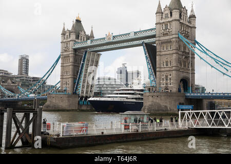 """London, UK. 29th Apr, 2019. Le Champlain cruise ship passes under Tower Bridge in London.Le Champlain is the second ship of the Ponant Explorers-class of cruise ships operated by Ponant. Each member of the class has been allocated the name of a famous French explorer, and Le Champlain is named after Samuel de Champlain, 'The Father of New France"""". Credit: Keith Larby/Alamy Live News - Stock Image"""
