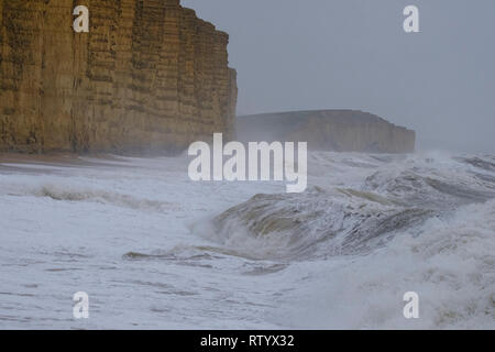 West Bay, UK. 3rd March, 2019. Huge waves from Storm Freya batter West Bay beach .Met Office has issued a yellow warning for much of the southwest UK Wind gusting to of over 60mph expect causing disruption and damage. Credit: PaulChambers /Alamy Live News - Stock Image