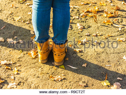 Women legs in jeans and boots in the autumn. - Stock Image
