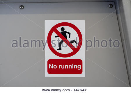 Sign warning people not to run in a London City train station - Stock Image
