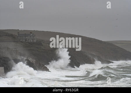 Porthleven, Cornwall, UK. 12th Mar, 2019. UK Weather. Storm Gareth pounds the coast of Cornwall at Porthleven, with huge waves and wins in excess of 60 mph Credit: Simon Maycock/Alamy Live News - Stock Image