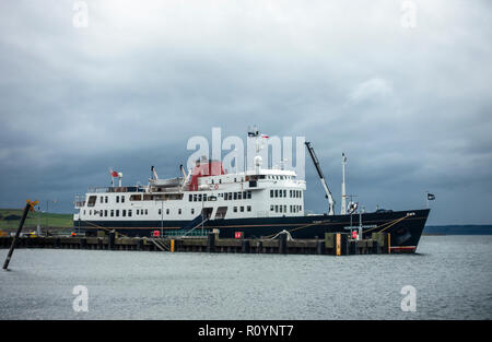 The MV Hebridean Princess, a small luxury cruise ship, berthed at the pier at Largs, a seaside resort in the Firth of Clyde, on a November morning. Sc - Stock Image