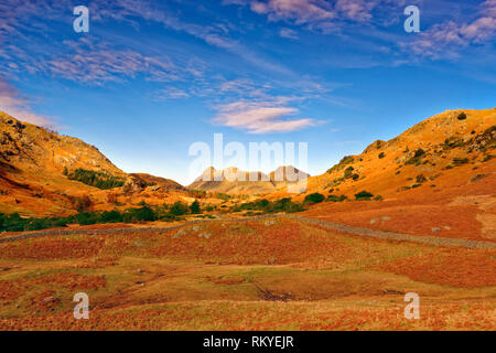 An autumn view of the Langdale Pikes in the distinctive landscape of the English Lake District. - Stock Image