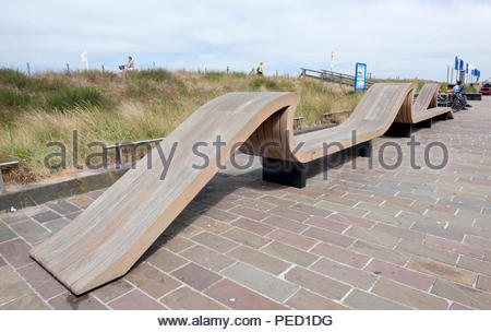 Noordwijk The Netherlands Park feature. Idiosyncratic benches in the shape of a wave. - Stock Image