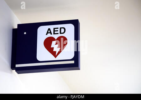 Automatic External Defibrillator AED Sign on a wall at an airport. - Stock Image