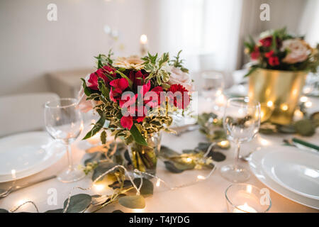 A table set for a meal indoors in a room on a party, a wedding or family celebration. - Stock Image