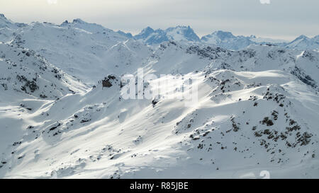 Courchevel Ski Resort Les 3 Vallees Rhone Alpes Savoie France La Saulire Cablecar to the top view towards Meribel and the 3 Valleys mountains and snow - Stock Image
