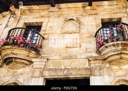 Coat of arms and balconies, Santillana, Spain - Stock Image