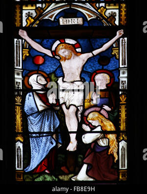 East window by Lavers, Berraud and Westlake, depicting the Crucifixion, St Peter's Church, Deene, Northamptonshire - Stock Image