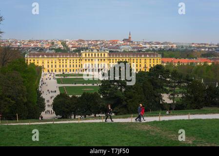 Schonbrunn Palace, view from Gloriette Hill of the parterre garden and baroque exterior of the Schloss Schönbrunn palace in Vienna, Austria. - Stock Image