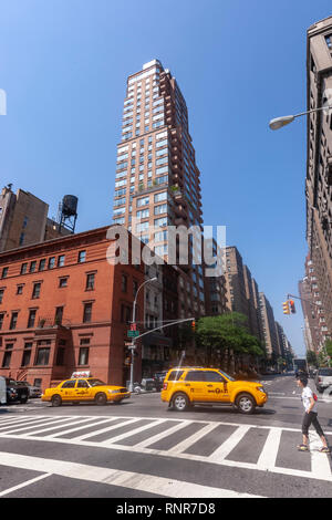 Crossing of Madison Avenue and E84 Street, New York City, USA - Stock Image