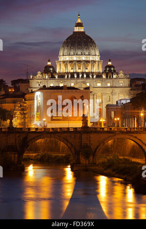 Tiber with Sant'Angelo bridge and the St. Peter's Basilica in Rome, Italy - Stock Image