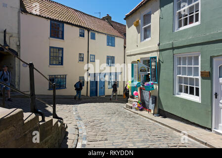 Church Street which is a cobbled street at the foot of the 199 steps in Whitby. - Stock Image