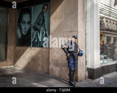 BELGRADE, SERBIA - SEPTEMBER 17, 2017: Serbian policeman standing in front of a fashion store with anti riot gear in the center of Belgrade, Serbia, d - Stock Image