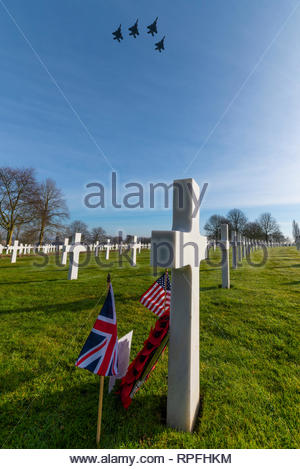 Madingley, Cambridgeshire, UK. 22nd Feb 2019. A flypast of US and RAF aircraft has been organised to fly over the crash site of B-17 bomber 'Mi Amigo' for the 75th anniversary of the event in Sheffield. The USAF F-15 fighters continued on to the Cambridge American Cemetery at which 3 of the 10 man crew are interred. Staff Sgt Harry W Estabrooks, Sgt Maurice D Robbins and Sgt Charles H Tuttle were remembered in a ceremony at the cemetery prior to the flypast.  Their inscriptions highlighted with sand from Normandy Beaches. Other 7 crew returned to US. Credit: Avpics/Alamy Live News - Stock Image