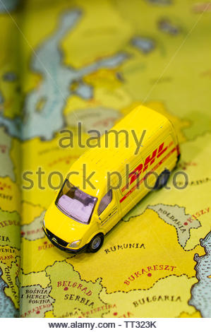 Toy Siku DHL delivery van on a map from a open educational book on circa June 2019 in Poznan, Poland. - Stock Image