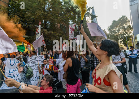 London, UK. 3rd July 2018. Protesters outside Southwark Council Offices hold banners, placards and smoke flares calling on the Council Planning Committee to reject the plans by tax avoiding property giant Delancey and University of the Arts London to demolish the Elephant & Castle Shopping Centre  and replace it with luxury housing and a new building for the London College of Communication. Credit: Peter Marshall/Alamy Live News - Stock Image