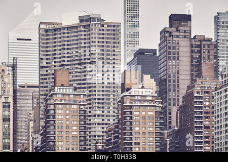 Manhattan cityscape seen from the Roosevelt Island, color toning applied, New York City, USA. - Stock Image