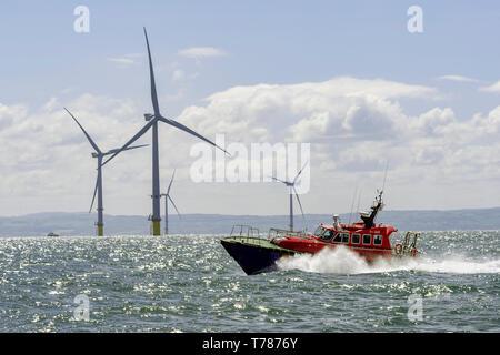 Liverpool pilot launch. River Mersey windfarm windmills. - Stock Image