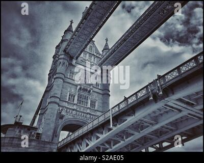 An unusual view of Tower Bridge - a view looking up from a boat on the River Thames. Tower Bridge is a Grade 1 Listed Building and a Tourist must see in London, England. Photo Credit © COLIN HOSKINS. - Stock Image