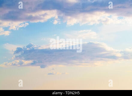 Blue sky clouds background. Beautiful landscape with clouds and sun - Stock Image
