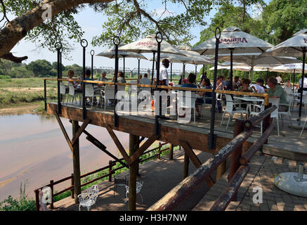Elevated decked restaurant  overlooking the game in Kruger Park at Skukuza Rest Camp Kruger Park South Africa - Stock Image
