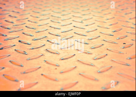 Red industrial metal sheet with shallow depth of field - Stock Image