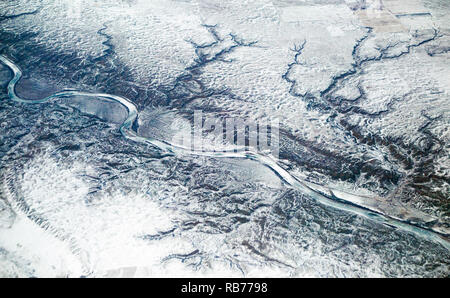 Dendritic river drainage pattern in prairie landscape, aerial view of the Red Deer River  and rangeland in winter southeast of Dorothy, Alberta - Stock Image