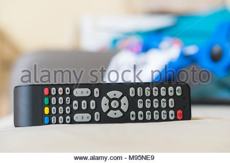 Television remote controller in soft focus - Stock Image