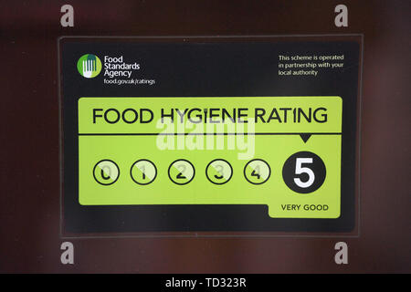 Embargoed to 0001 Wednesday June 12 File photo dated 25/03/17 of a Food Standards Agency (FSA) rating sticker on a window of a restaurant in central London. Regulation to ensure food safety is showing 'signs of strain' as local authorities cut staff and delay checks, a spending watchdog has found. - Stock Image