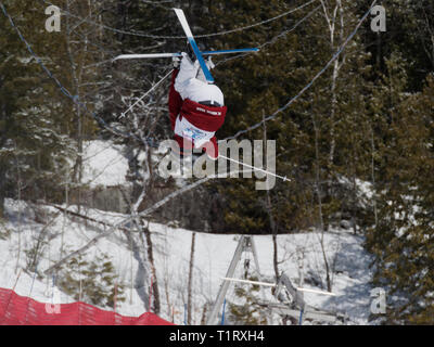 Quebec,Canada .Freestyle Canada ,Brayden Kuroda of the BC Mogul team competes at the National Freestyle Moguls Championship at Val Saint-Come - Stock Image