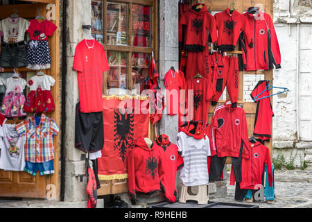 Shops Korca, main Plaza, Albania, selling sports wear with Albanian flag design - Stock Image