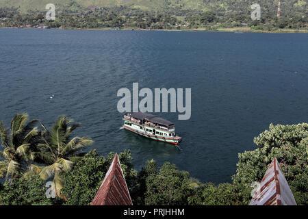 Wooden ferry boat at Samosir Island on Lake Toba, Sumatra, Indonesia - Stock Image
