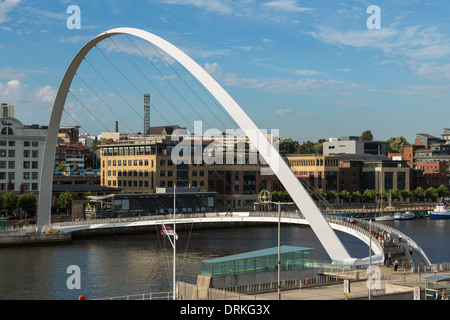 People walk Gateshead Millennium Bridge, Newcastle on Tyne, England - Stock Image