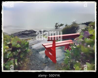 Red bench and ocean view - Stock Image