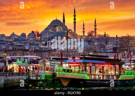 Fatih district with the Süleymaniye Mosque and the Eminönü square with traditional boats selling the traditional Balik Ekmek (a grilled fish sandwich) - Stock Image
