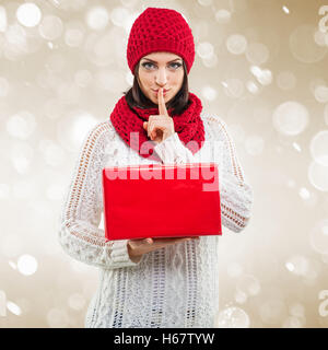 Santa Women, with red gift box - Stock Image