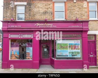 Shop front of Transindus - a luxury, tailor-made, Asian travel specialist, on St Mary's Road, Ealing, London W5, England, UK. - Stock Image
