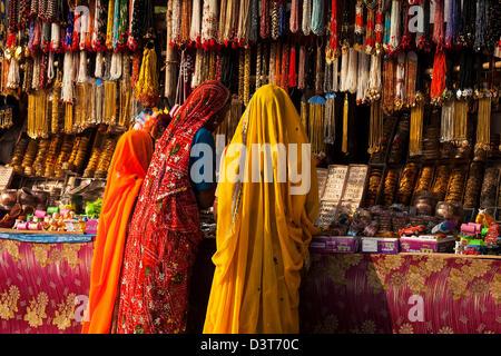 Women, Bangles and Beads - Stock Image